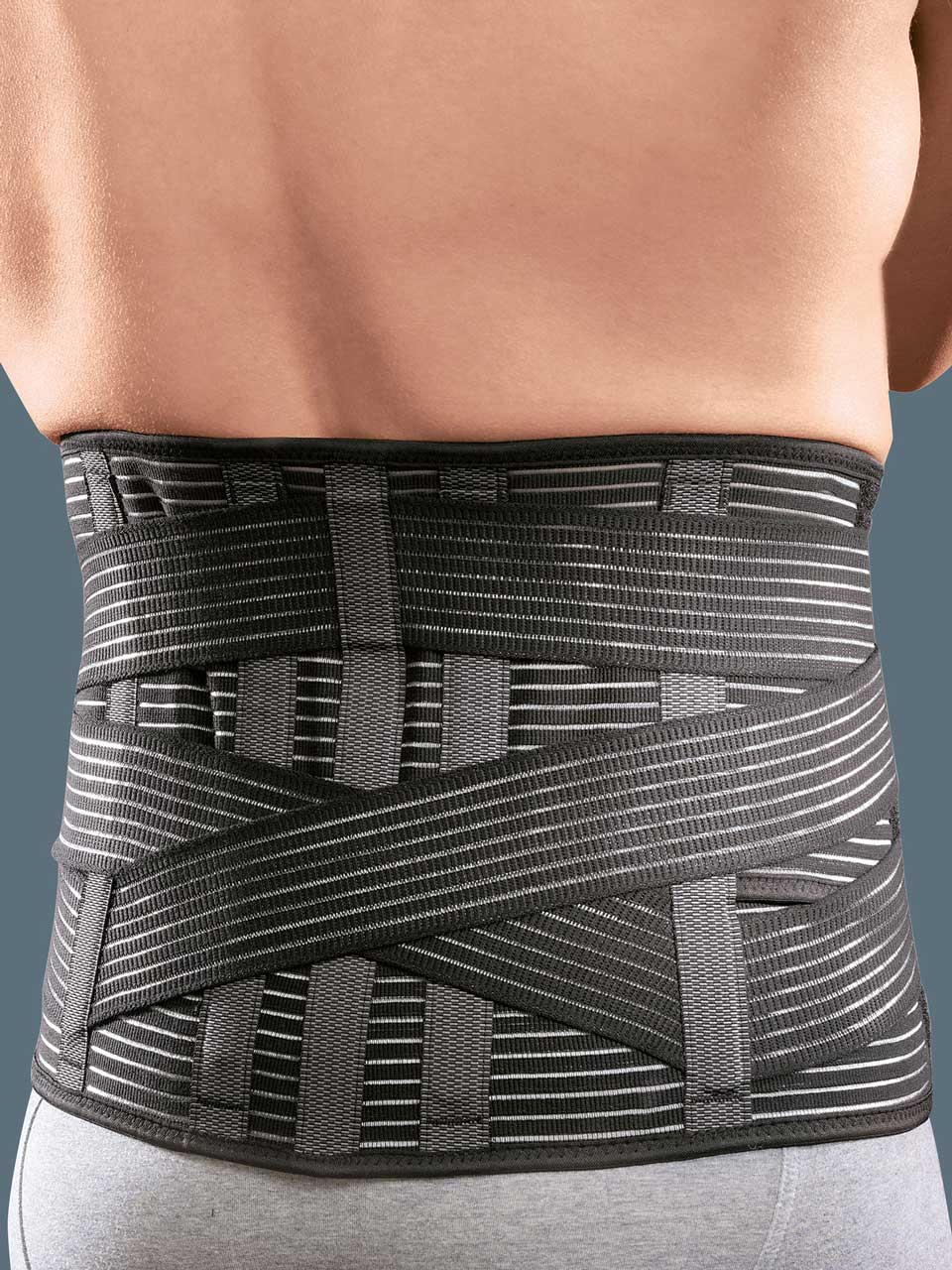Low elastic orthosis with elastic straps for stabilising and supporting the lumbar spine, with thermoformable pad